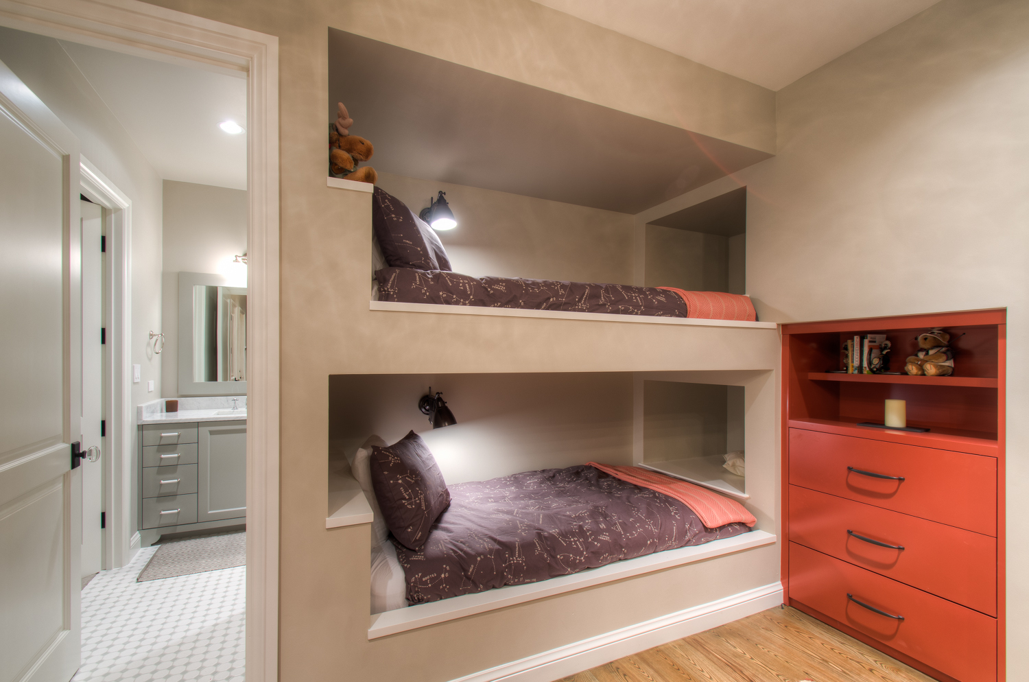 In-wall Twin Beds with Storage Cubbies and Built-ins