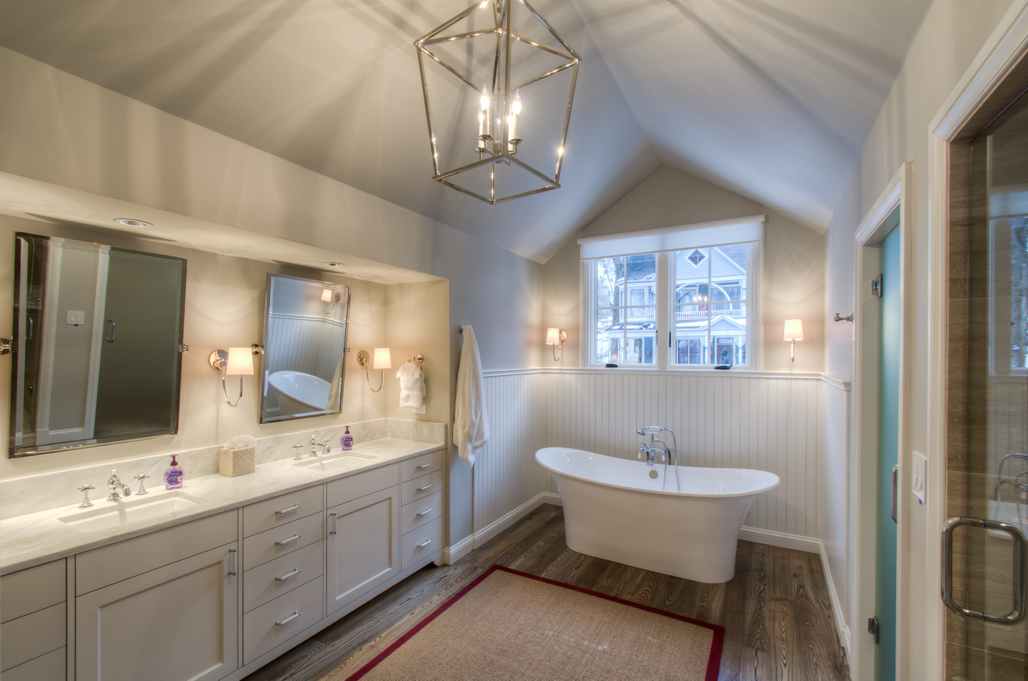 Master Bathroom with Dual Vanity, Soaking Tub, and Walk-in Shower