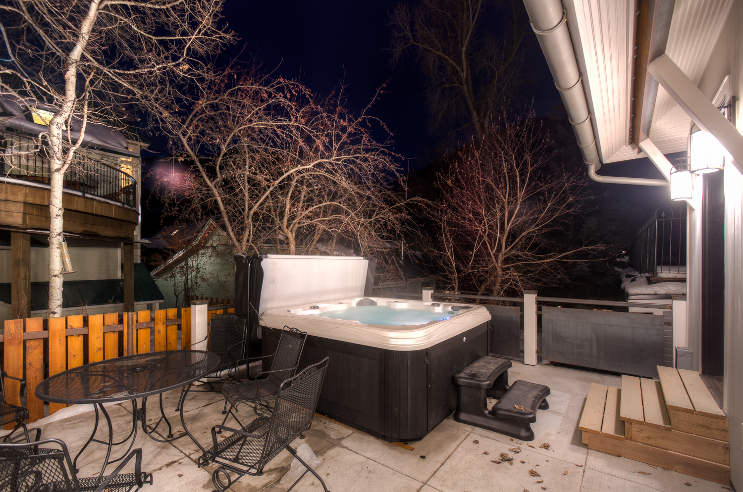 Back Patio with Hot Tub and Outdoor Seating for 6 at Miles High