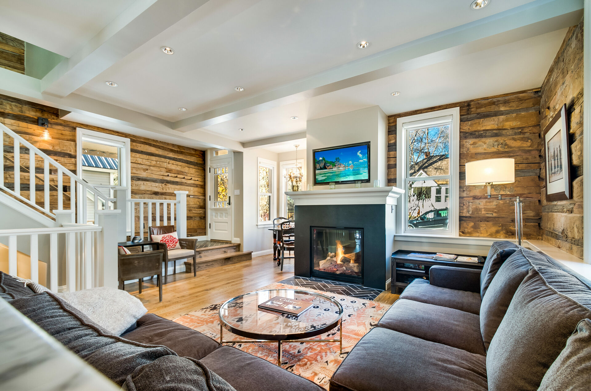 Living Room with Fireplace and Flat-Screen TV Surrounded by Wood Panel Walls