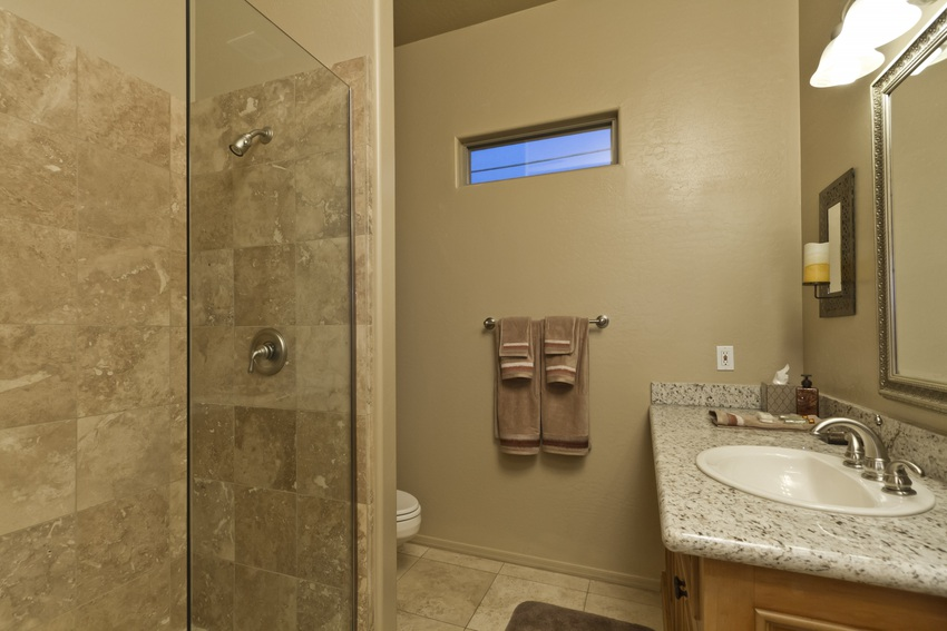 The guest bathroom has a great walk-in shower