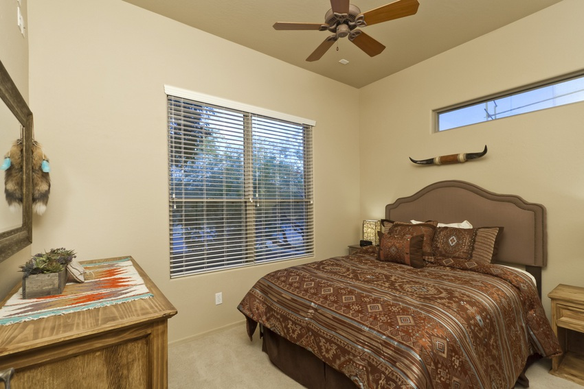 Rich chocolate tones cover this bed and warm the bedroom