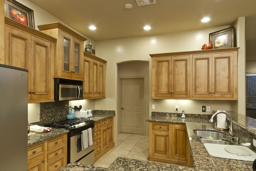 Lots of counter space surrounding stainless steel appliances
