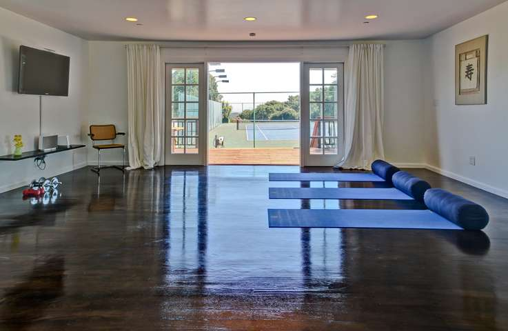 The gym overlooking the tennis court