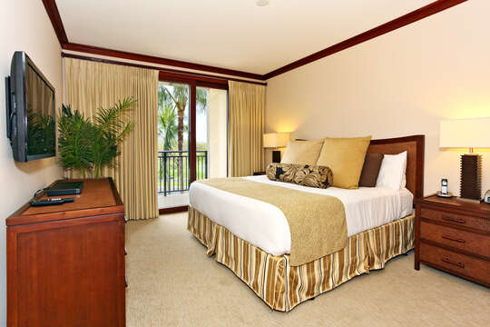 Our Beach Rental in Oahu Hawaii's Large Master Bedroom with Access to Private Lanai