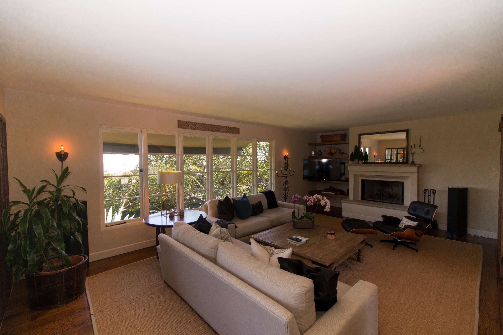 Living room with garden views and wet bar