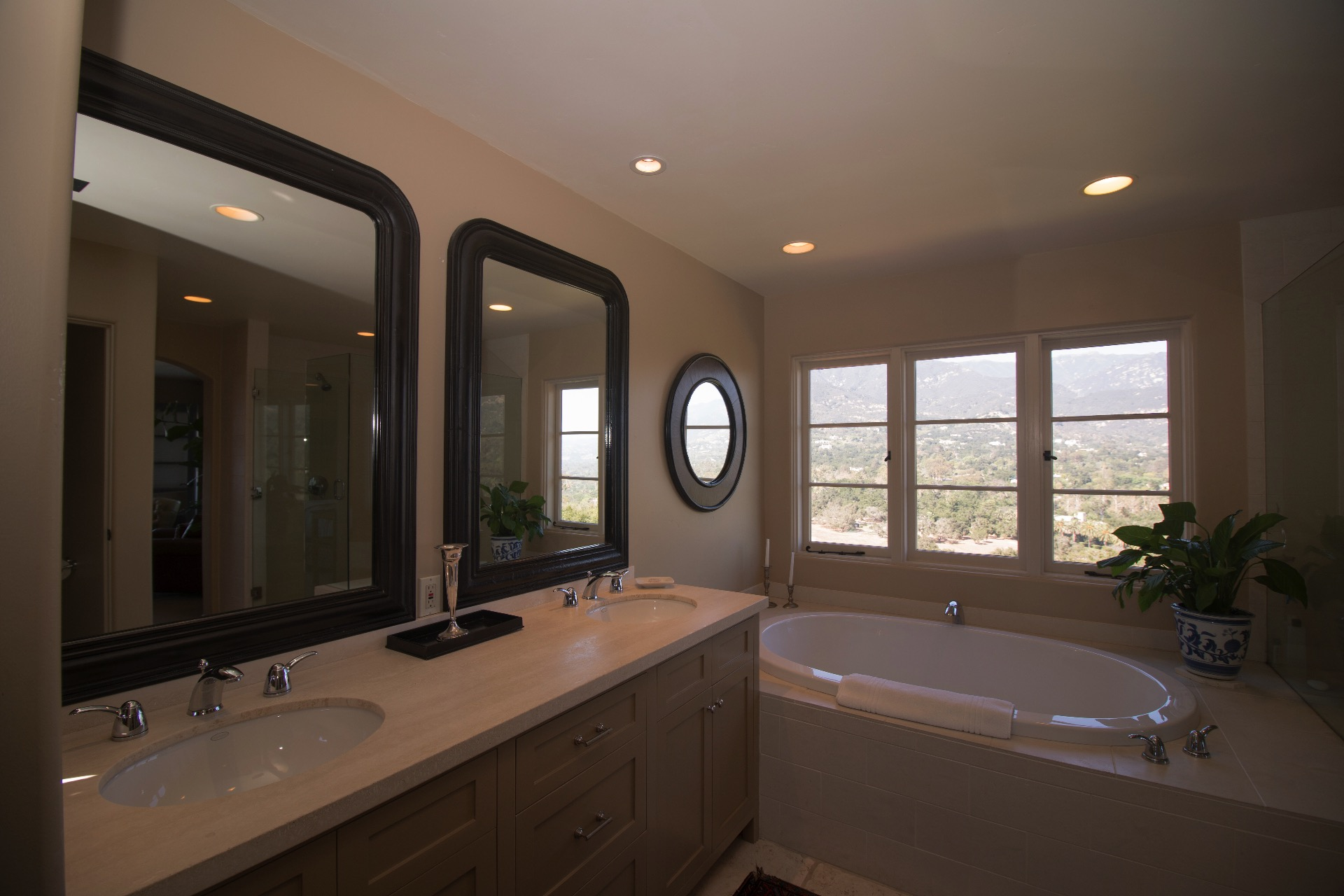 Master bathroom with two sinks, soaking tub and mountain views