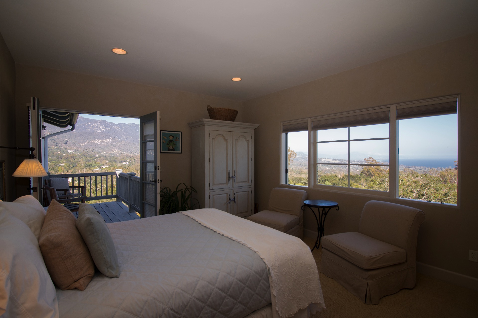 Guest bedroom upstairs has mountain and ocean views