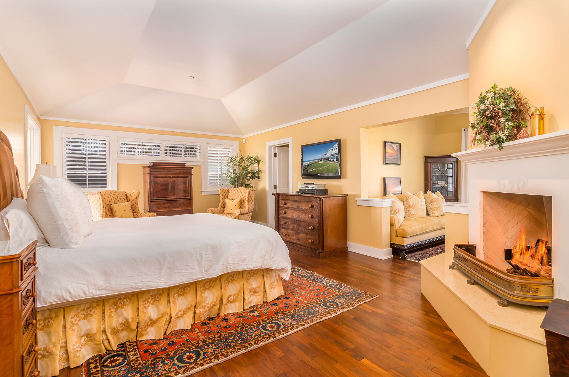 Downstairs master suite with King bed, flat screen TV, gas fireplace, double doors out to backyard and ocean views.