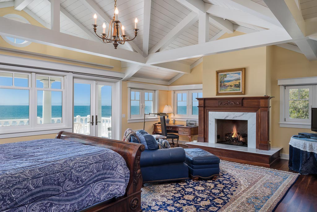 Master Bedroom upstairs with Cozy Fireplace with expansive ocean views