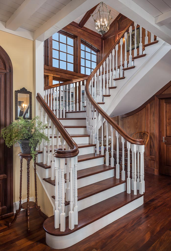 Beautiful staircase leads to upstairs second laundry, decks, and 2 master suities