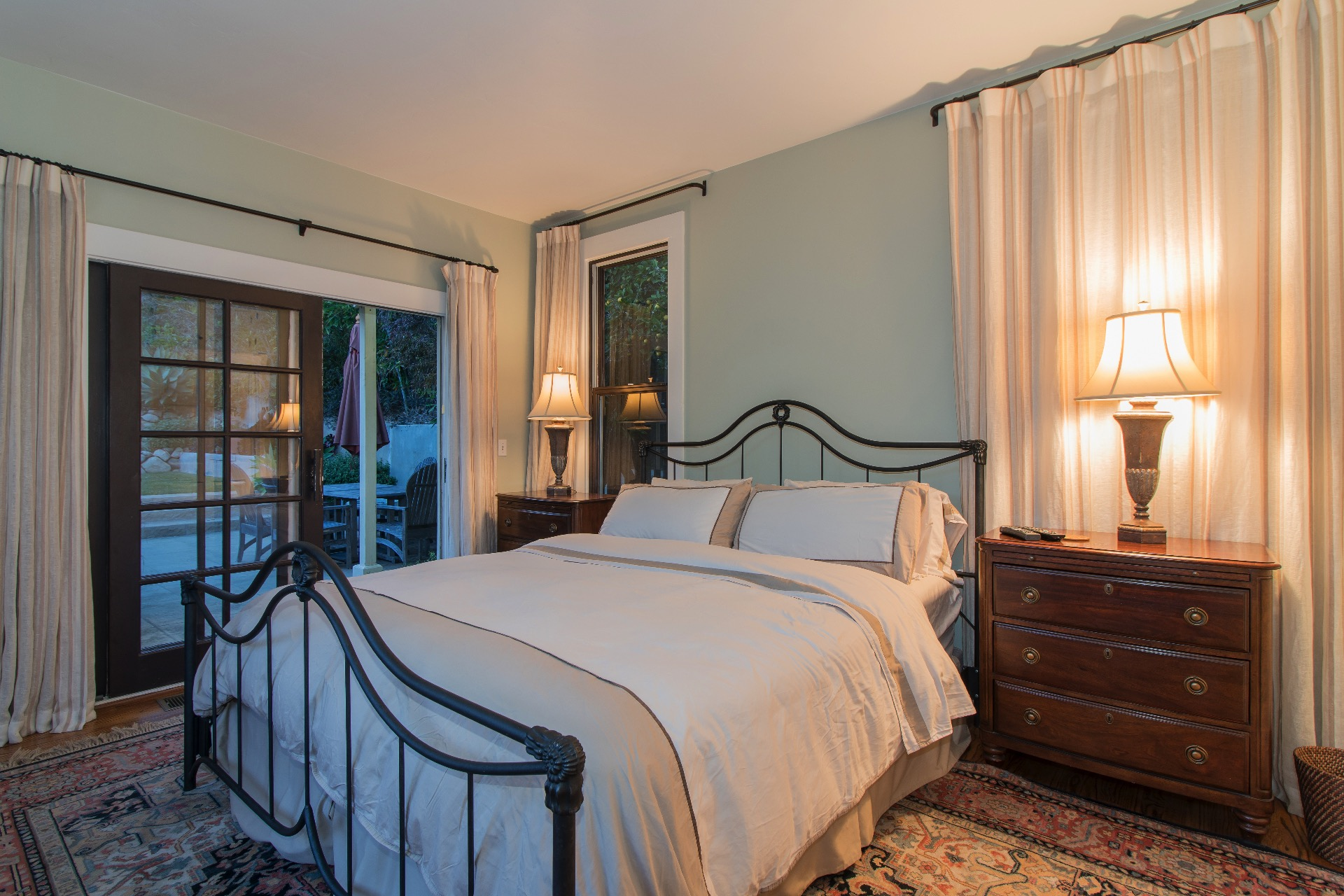 Master suite with french doors leading to totally cute fenced in back yard and upper deck!