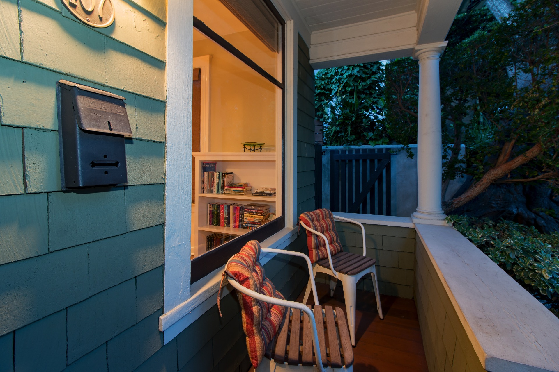 Cozy front porch with two chairs.