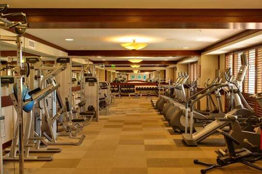 Fitness Center with many different workout machines.