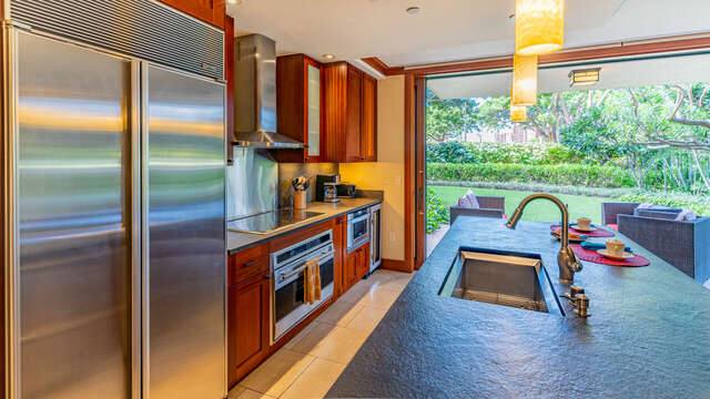 Kitchen with View of lanai, modern amenities, and plenty of seating.