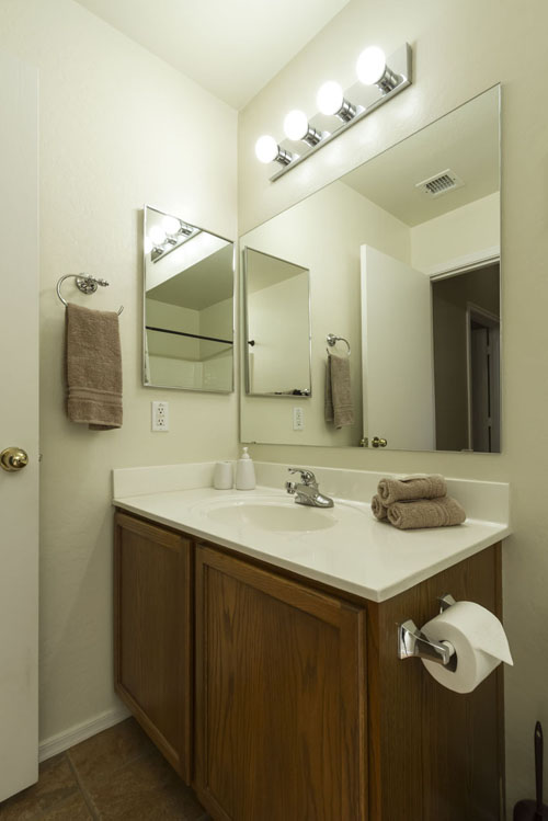 guest bathroom with single sink.