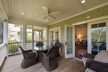 Fabulous screened in porch off the living room and dining room overlooks Palmetto Lake.