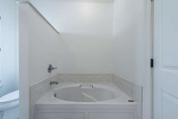 There is a deep tub perfect for soaking in after a day of golf or tennis.