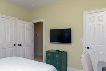 There is a mounted HDTV & Jack n Jill bathroom that connects to both BR2 & BR3.