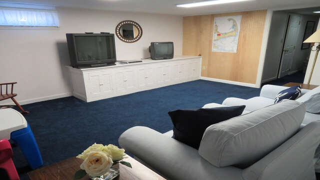 Bonus area on the lower level with comfy seating and TV + VCR - 26 Ridgevale Road South Harwich Cape Cod New England Vacation Rentals