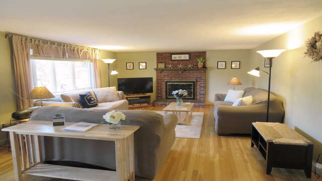 The living room has plenty of seating, and a LArge Flat screen TV. The home offers Central AC to keep you cool and WiFi to keep you connected - 26 Ridgevale Road South Harwich Cape Cod New England Vacation Rentals