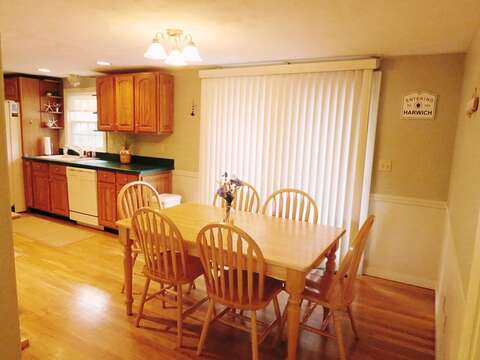 Dining table and sliding doors to the back deck - 26 Ridgevale Road South Harwich Cape Cod New England Vacation Rentals
