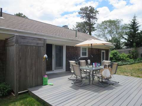 Another view of the deck, outdoor shower, outdoor dining area, and gas grill - 26 Ridgevale Road South Harwich Cape Cod New England Vacation Rentals
