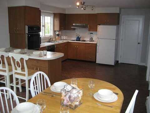 Open Kitchen with Dining and sliders to back deck - 13 Monomoy Circle Chatham Cape Cod New England Vacation Rentals