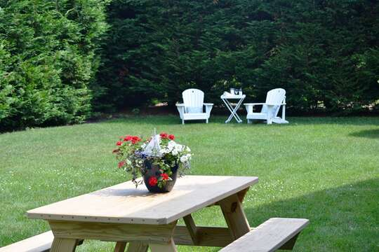 Exterior back with picnic table and Adirondack chairs - 13 Monomoy Circle Chatham Cape Cod New England Vacation Rentals