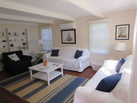 Living room with central air slim line unit to keep the house cool and wifi to keep you connected- 13 Monomoy Circle Chatham Cape Cod New England Vacation Rentals