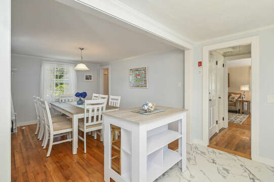Kitchen opens to dining room with a movable island- 54 Hiawatha Road Harwich Port Cape Cod New England Vacation Rentals