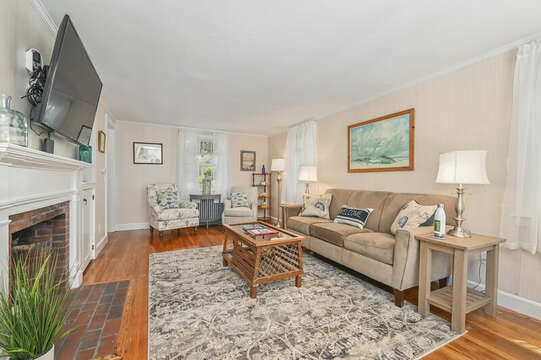 Refreshed Living room with couch, chair and flat screen tv-54 Hiawatha Road Harwich Port Cape Cod New England Vacation Rentals