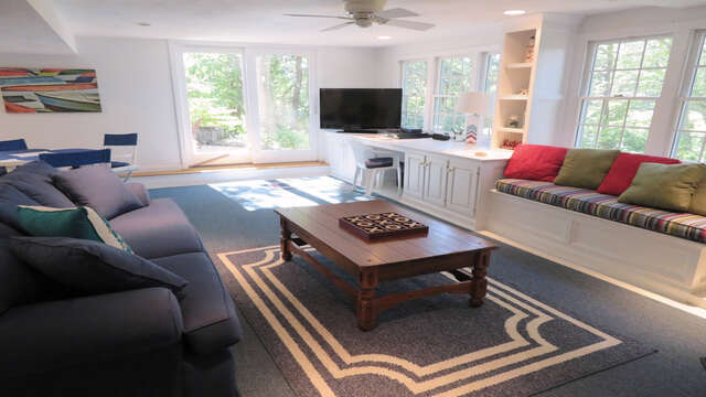 Comfy seating to watch your favorite movie-Doors lead to outdoor shower and patio area-138 Soundview Avenue Chatham Cape Cod New England Vacation Rentals