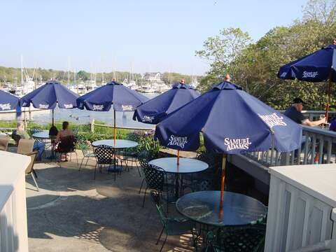 Have dinner on the patio at Brax Landing overlooking Saquatucket Harbor - Harwich Port Cape Cod New England Vacation Rentals