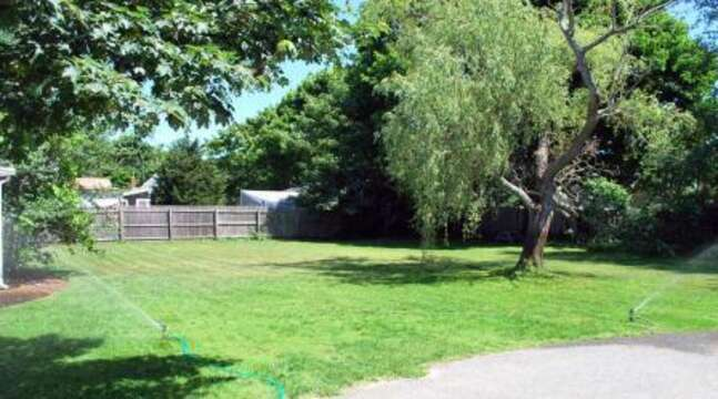 Large yard- enjoy a good game of badminton or croquet! - 45 Route 28 West Harwich Cape Cod New England Vacation Rentals