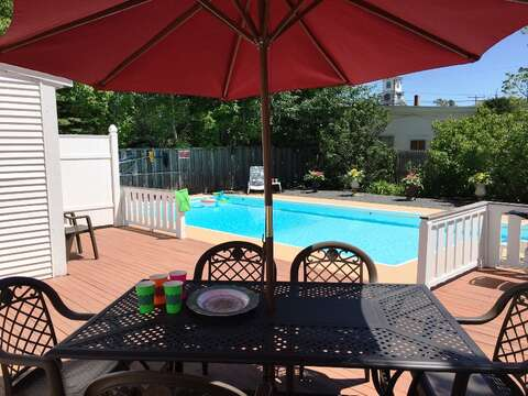 Lovely outdoor dining by the pool - 45 Route 28 West Harwich Cape Cod New England Vacation Rentals