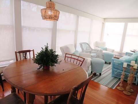 Enclosed sunroom with seating and a game table - 14 Ivy Lane Chatham Cape Cod New England Vacation Rentals