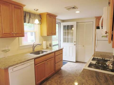 Updated kitchen with a dishwasher. Access to the back patio from the door  to the right of the sink - 37 Jacqueline Circle West Yarmouth Cape Cod New England Vacation Rentals