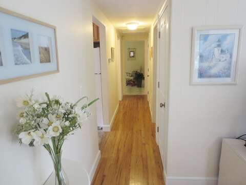 Looking down the hallway from the living room. Down this hall you'll find  the 3 bedrooms - 37 Jacqueline Circle West Yarmouth Cape Cod New England Vacation Rentals