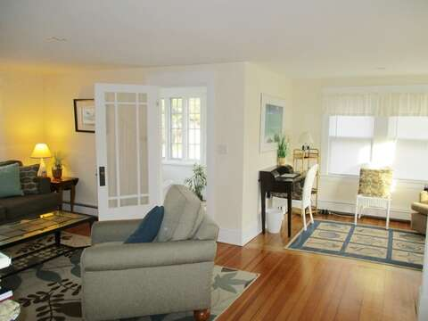 The open living area offers easy access to the sunporch - 36 Cross Street Harwich Port Cape Cod New England Vacation Rentals