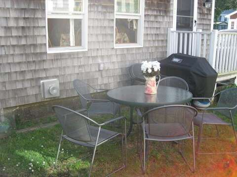 Quaint back patio dining area with a gas grill - 17 Ocean Avenue Harwich Port Cape Cod New England Vacation Rentals