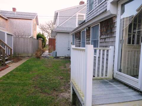 Small side yard leads to outdoor shower - 17 Ocean Avenue Harwich Port Cape Cod New England Vacation Rentals