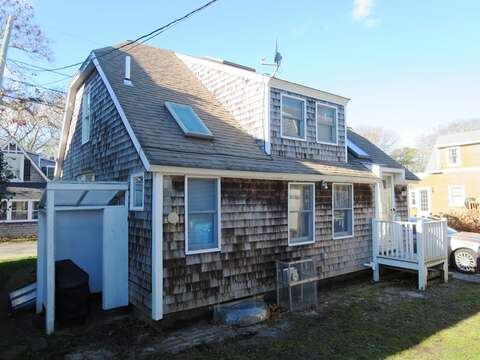 The back of the home, offering an outdoor shower - 17 Ocean Avenue Harwich Port Cape Cod New England Vacation Rentals
