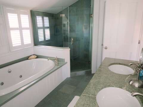 Full bath with double vanity, shower, and tub. En suite - Bedroom #5 -14 Hallett Lane Chatham Cape Cod New England Vacation Rentals