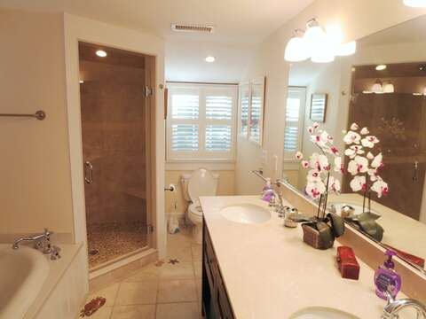 En suite full bath with double vanity to Bedroom #1 on main level - 14 Hallett Lane Chatham Cape Cod New England Vacation Rentals