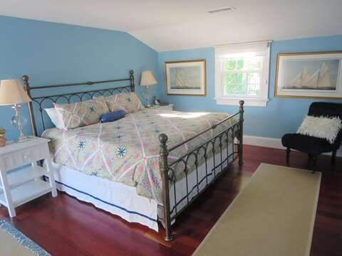 Main floor Bedroom #1 with King bed, flat screen TV, en suite bath, and sliders to deck - 14 Hallett Lane Chatham Cape Cod New England Vacation Rentals