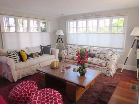 2nd seating area in living room with sliders to back patio - 14 Hallett Lane Chatham Cape Cod New England Vacation