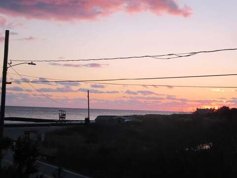 View of the sunset over Nantucket Sound from the upper deck - South Harwich Cape Cod New England Vacation Rentals