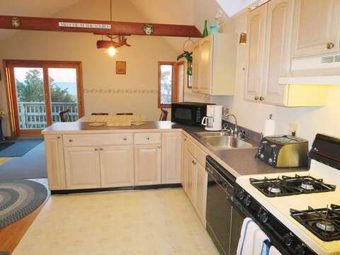 Open and fully equipped kitchen with sliders to the deck - 17 Uncle Venies South Harwich Cape Cod New England Vacation Rentals