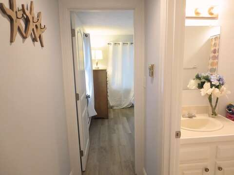 Hallway to 1st floor bedroom and bath - 15 Oyster Drive Chatham Cape Cod New England Vacation Rentals